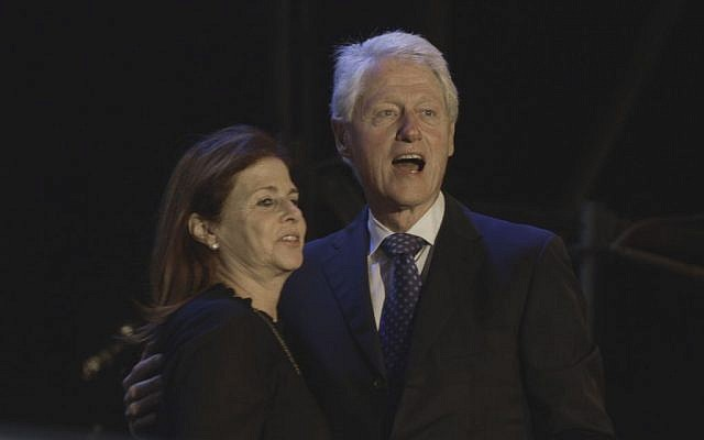 Former US President Bill Clinton hugs Dalia Rabin, the daughter of the late Israeli prime minister Yitzhak Rabin, during a rally marking 20 years since Rabin's assassination, Saturday, Oct. 31, 2015 in Tel Aviv, Israel. (AP Photo/Sebastian Scheiner)