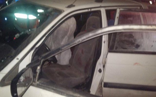 The car in which Israeli couple Naama and Eitam Henkin were shot dead in a terror attack near the West Bank settlement of Itamar on Thursday, October 1, 2015. (United Hatzalah)