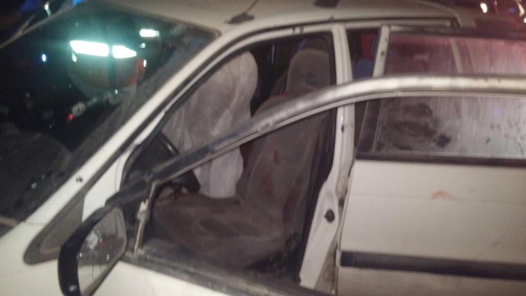The car in which Israeli couple Naama and Eitam Henkin were shot dead in a terror attack near the West Bank settlement of Itamar on Thursday, October 1, 2015. (Courtesy United Hatzalah)