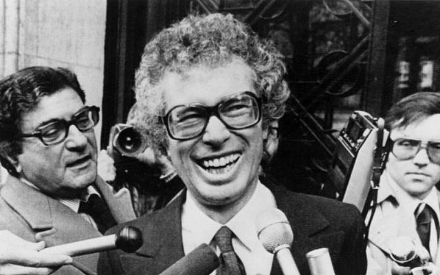In this Jan. 31, 1980, file photo, Ken Taylor, Canadian Ambassador to Iran, laughs as he answers questions during a meeting with journalists outside the Canadian Embassy in Paris. (AP Photo/File)