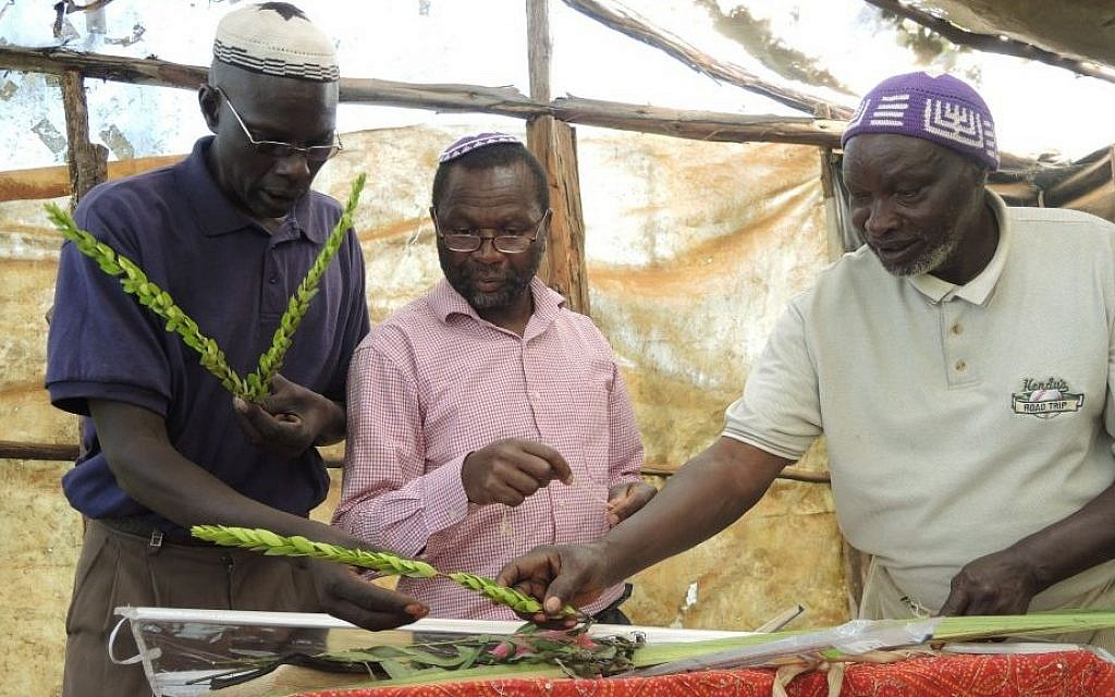 Members of the Kasuku Jewish Community in Kenya put together the lulav and etrog for the first time on October 5, 2015. (Melanie Lidman/Times of Israel)