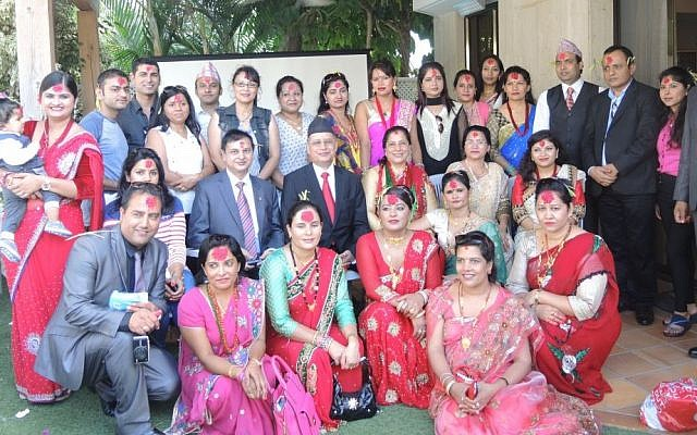 Nepalese Ambassador to Israel Prahlad Kumar Prasai (in the center, with a black hat and red tie) hosts Nepalis living in Israel at his residence in Herziliya for Dashain celebrations on October 22. Tamang skipped the festivities so he could go to the Dead Sea, though he visited Ambassador Prasai later that evening. (Melanie Lidman/Times of Israel)