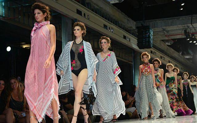 Yaron Minkowski's models draped in keffiyehs as a symbol of Fashion Week coexistence (Courtesy Idocvm and Mark Oren/TLV Fashion Mall)
