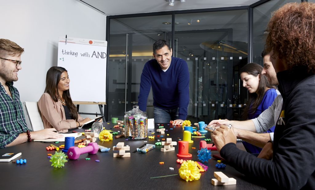 Daniel Lubetzky, CEO and founder of Kind Snacks, with members of his team at the company's New York City headquarters. (Poon Watchara-Amhaiwan/via JTA)