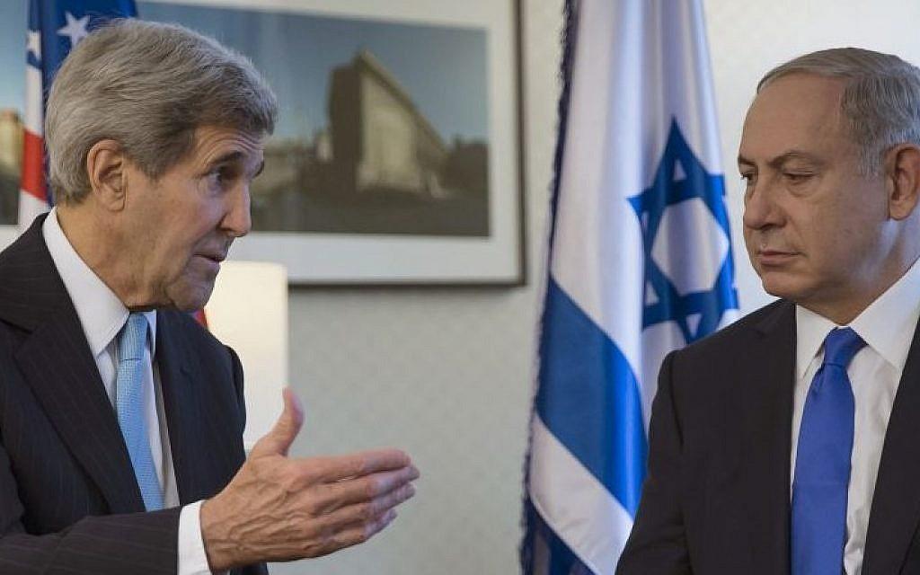 US Secretary of State John Kerry, left, speaks with Prime Minister Benjamin Netanyahu during a meeting in Berlin, Germany, Thursday, October 22, 2015. (Carlo Allegri/Pool Photo via AP)