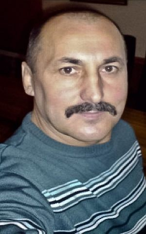 """Alexandr Agheenco, a Russian citizen based in Moldova's breakaway region of Trans-Dniestr, and called """"the Colonel"""" by his cohorts. (Moldova Police via AP)"""