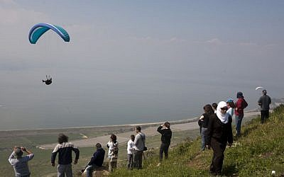People watch a paraglider near the Golan Heights in 2009 (illustrative photo: Matanya Tausig/Flash 90)