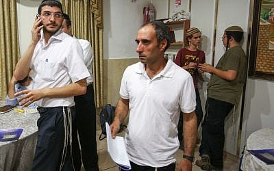 Hagai Amir, center, at a ceremony in Jerusalem on November 1, 2012, marking the anniversary of the death of Meir Kahane. (Oren Nahshon / FLASH90)