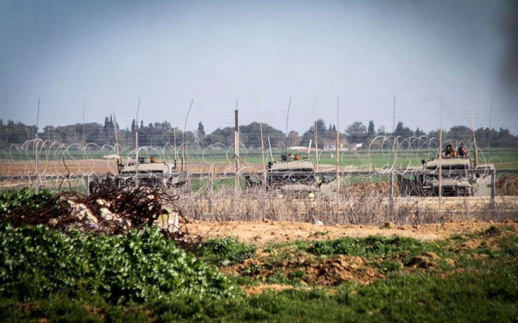 Illustrative: Israeli forces next to the security fence on the border between Israel and southern Gaza Strip. (Abed Rahim Khatib/Flash90)