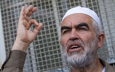 Leader of the northern branch of the Islamic Movement in Israel, Sheikh Raed Salah, arrives at the Magistrate court in Jerusalem on March 26, 2015, to receive his sentencing for incitement to violence and racism against Jews (Miriam Alster/Flash90)