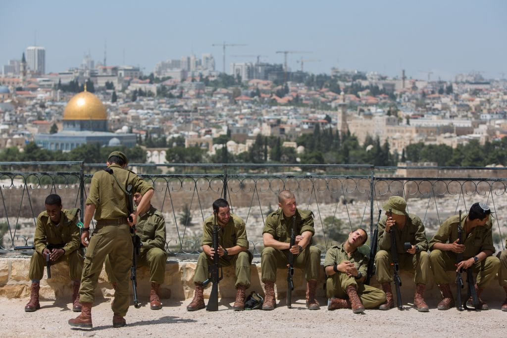 With the Temple Mount in the background, Israeli soldiers are seen during preparation for a Memorial Day ceremony at the Mount of Olives in Jerusalem on April 21, 2014 (Yonatan Sindel/Flash90)