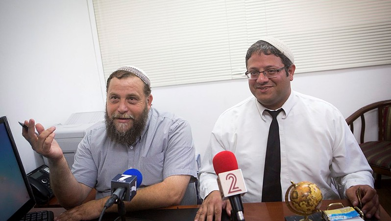 Leader of the far-right Israeli group Lehava, Bentzi Gopshtain (L), seen at a press conference with his lawyer Itamar Ben Gvir, in Jerusalem on August 11, 2015. (Miriam Alster/Flash90)