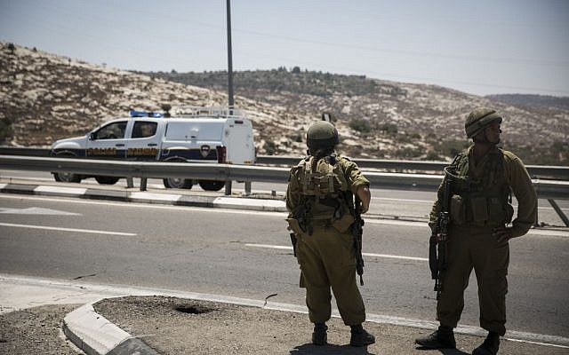 Israeli soldiers and security man West Bank road north of Jerusalem, illustrative (Hadas Parush/Flash90)