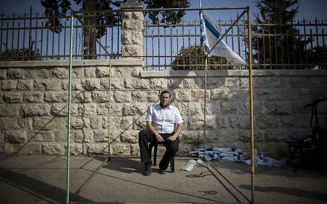 "Yossi Dagan, head of the Samaria Regional Council, sits at a Sukka outside the Prime Minister's Residence in Jerusalem on October 2, 2015. Dagan announced that he was starting a hunger strike protest in the wake of the murder of Israeli couple, Naama and Eitam Henkin, to demand what he called ""an appropriate response"" from Prime Minister Benjamin Netanyahu (Photo by Yonatan Sindel/Flash90)"