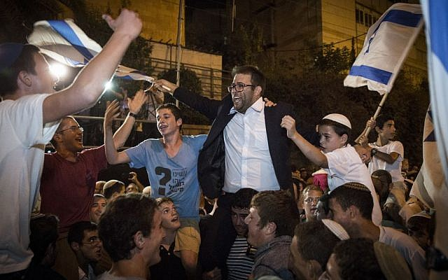 Likud Knesset Member Oren Hazan dances with demonstrators from the Samaria settler's council during a demonstration outside the prime minister's residence in Jerusalem, October 5, 2015 (Hadas Parush/Flash90)