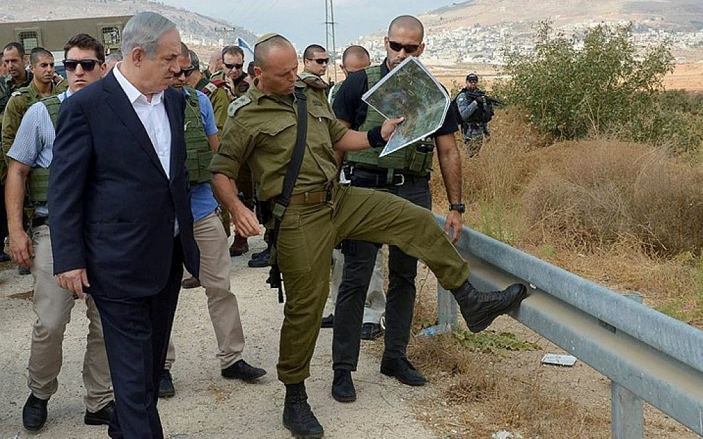 Prime Minister Benjamin Netanyahu (L) seen as he visits the Judea and Samaria area on October 6, 2015, Following recent terror attacks. (Amos Ben Gershom/GPO)