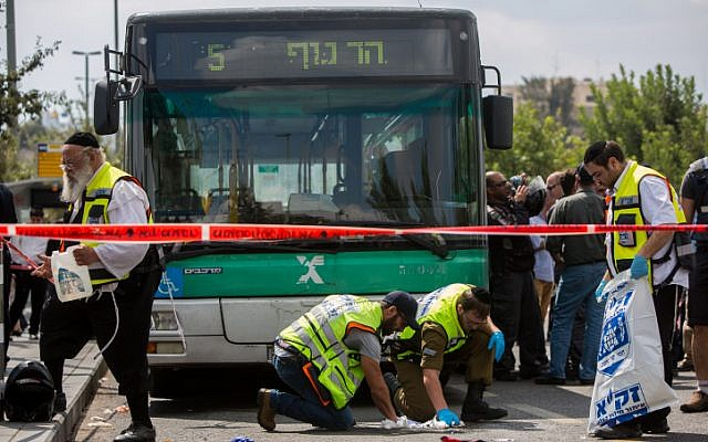 Rescue personnel at the scene of a stabbing attack at the lightrail station in Jerusalem on October 8, 2015. A Palestinian stabbed and wounded two Israeli Jews, a 4th incident in the past week in Jerusalem. (Photo by Yonatan Sindel/Flash90)