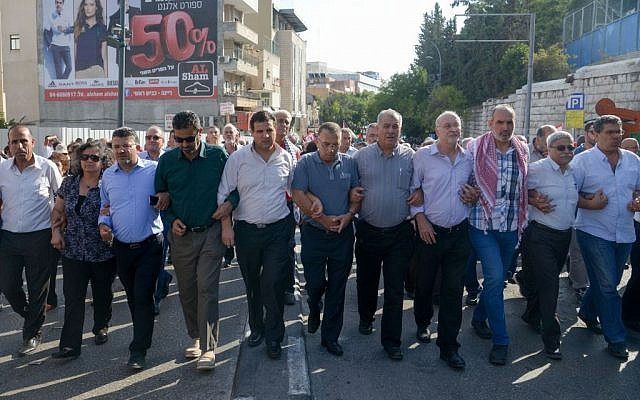 Members of the Hadash party in the Joint Arab List demonstrate against the government in Nazareth, October 10, 2015 Basel Awidat/Flash90