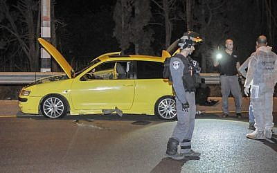 Police inspect the scene of a terror attack on route 65 in northern Israel, on October 11, 2015,  where an Israeli Arab man ran over a soldier and then stabbed her and three others at the Gan Shmuel Junction.  The soldier was seriously wounded.  The attacker was caught by police. (Flash90)
