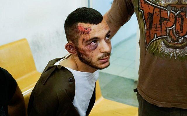 Suspect Alaa Raed Ahmad Zayoud at Haifa Magistrate's Court (Basel Awidat/Flash90)