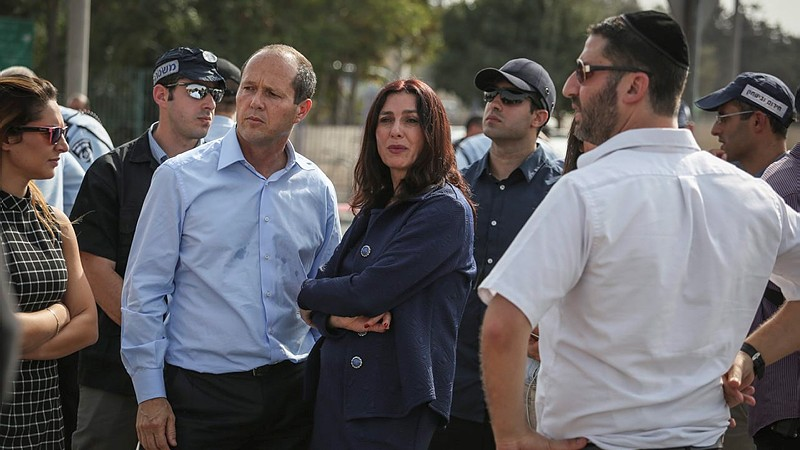 Jerusalem Mayor Nir Barkat and Culture Minister Miri Regev seen at the scene of a stabbing attack in front of the Police National Headquarters in Jerusalem on October 12, 2015. (Hadas Parush/Flash90)