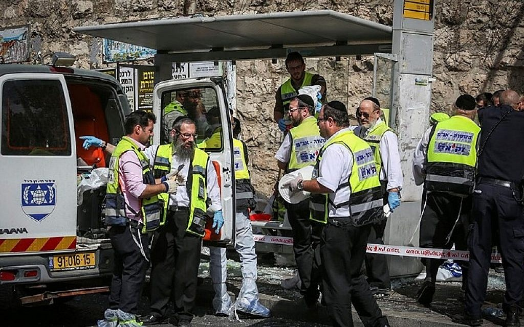 The site of a attack where a terrorist rammed his car into pedestrians and then got out and stabbed others, injuring at least 5 people, killing one, on Malchei Yisrael Street, in Jerusalem. October 13, 2015. (Hadas Parushl/FLASH90)