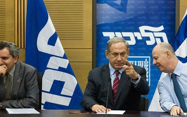 Benjamin Netanyahu, center, with Tzachi Hanegbi, right, and Zeev Elkin at a Likud faction meeting on October 19, 2015 (Miriam Alster/Flash90)