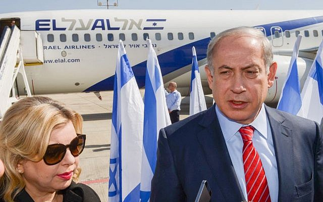 Prime Minister Benjamin Netanyahu and his wife Sara, upon boarding their flight at Ben Gurion International Airport to Berlin, October 21, 2015. (Amos Ben Gershom/GPO)