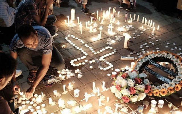 Memorial candles at a ceremony in Tel Aviv on October 21, 2015 to honor Haftom Zarhum, an Eritrean national who was killed in the Beersheba bus station attack. (Tomer Neuberg/Flash90)