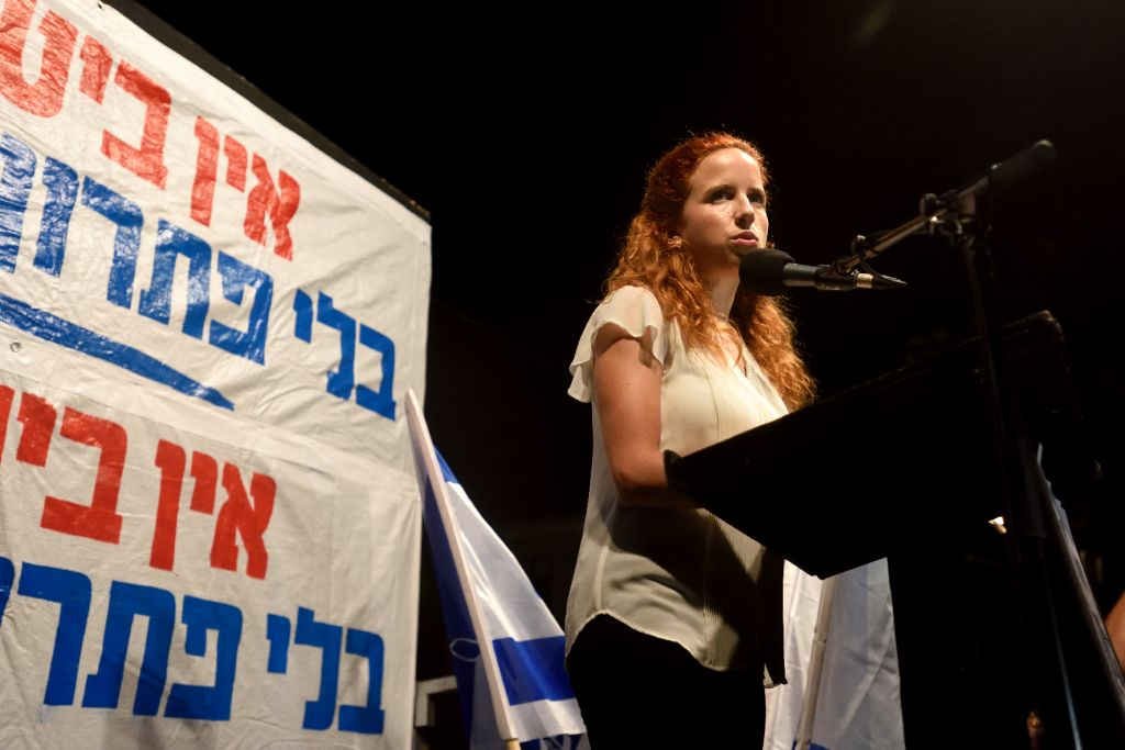 "MK Stav Shafir (Zionist Union) speaks to a demonstration in Tel Aviv. Thousands of left-wing activists protested on October 24, calling for the resignation of Prime Minister Benjamin Netanyahu in response to the surge in Palestinian terror attacks and what they called ""the loss of hope for Israelis."" (Photo by Gili Yaari. /Flash90)"