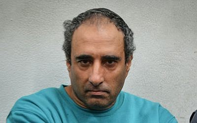 Hagai Amir attends a court session in Tel Aviv over a Faebook post that police say incited against President Reuven Rivlin, on Wednesday, October 28, 2015 (Flash90)