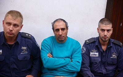 Haggai Amir, brother of the convicted murderer of former prime minister Yitzhak Rabin, attends a court session in Tel Aviv over a Facebook post in which he allegedly incited against President Reuven Rivlin, on Wednesday, October 28, 2015 (Flash90)