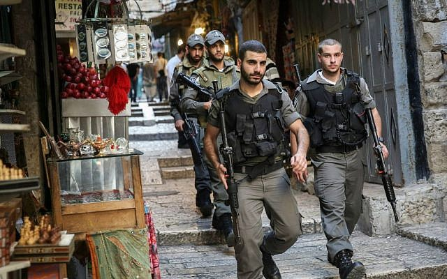 Border Police walk through the market near Jaffa Gate in Jerusalem's Old City, October 11, 2015. (Hadas Parush/Flash90)