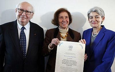 Serge Klarsfeld, 80 (left), French historian, lawyer and Holocaust survivor, and his 76-year-old German-born wife Beate Klarsfeld (right), along with the director-general of UNESCO, Irina Bokova, pose after being named UN special envoys and honorary ambassadors on genocide prevention at UNESCO headquarters in Paris, October 26, 2015. (AP/Francois Mori)