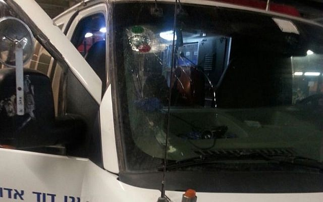 An ambulance sustained damage after being pelted with rocks near Hebron on October 3, 2015. (MADA)