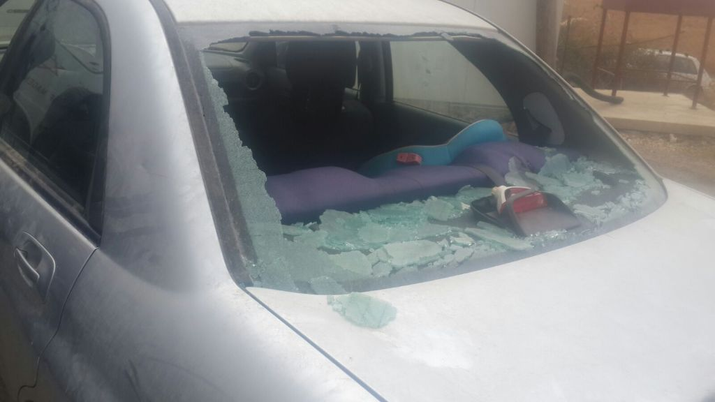 The smashed window of an Israeli vehicle after an attack by rock throwing Palestinians near the West Bank settlement of Tekoa, October 7, 2015. (Courtesy)