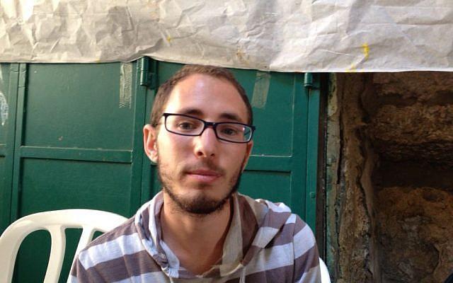 Elichi Wiesel sits at the protest tent on Hagai Street, in Jerusalem's Muslim Quarter, October 8, 2015 (Elhanan Miller/Times of Israel)