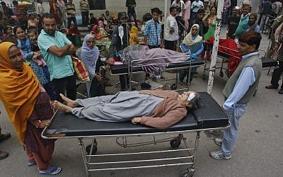 Patients who were shifted outdoors at the government medical college hospital after a strong tremor was felt in Jammu, India, Monday, Oct. 26, 2015. (Photo by AP Photo/Channi Anand)