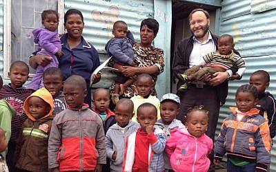 South African Jewish politician Jack Bloom with children at a daycare center in Soweto. (Courtesy)