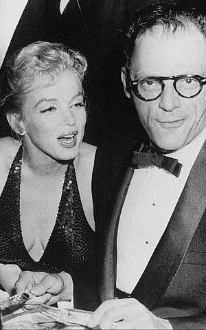 In this 1957 photograph, Arthur Miller and his second wife, actress Marilyn Monroe, enjoy the April in Paris gala (Wikimedia Commons)