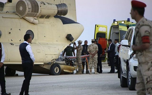 Egyptian emergency workers unload bodies of victims from the crash of a Russian aircraft over the Sinai Peninsula from a police helicopter to ambulances at Kabrit military airport, some 20 miles north of Suez, Egypt, Saturday, Oct. 31, 2015. (AP/Amr Nabil)
