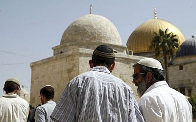 In this Thursday, July 28, 2015 photo, a group of religious Jews walk in front of the Dome of the Rock on Jerusalem's Temple Mount. (AP/Mahmoud Illean)