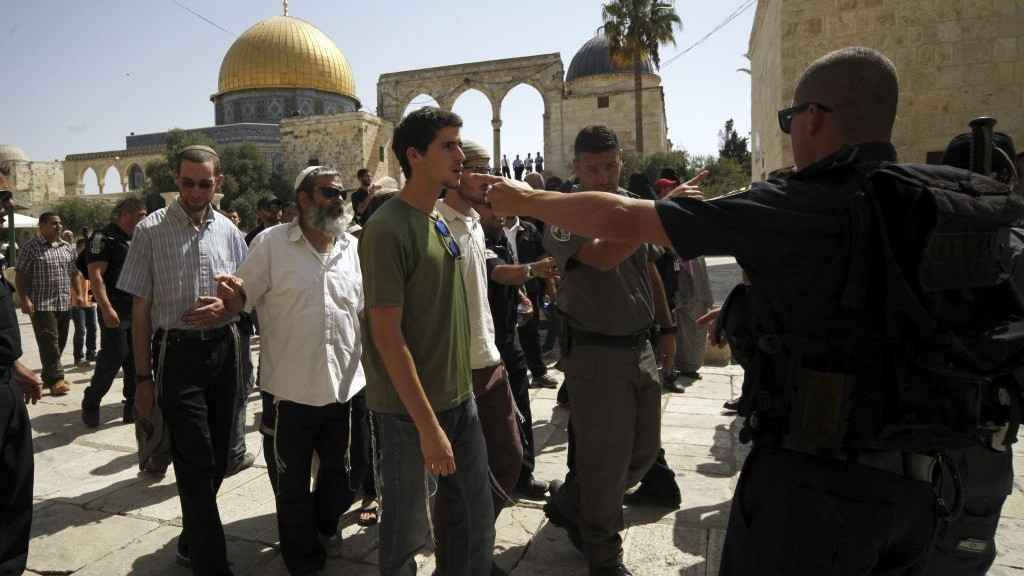 This Thursday, July 28, 2015 photo shows a group of religious Jews escorted by Israeli police at the Temple Mount in Jerusalem. (AP/Mahmoud Illean)