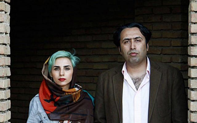 In this undated photo made available by International Campaign for Human Rights in Iran, Iranian poets Fatemeh Ekhtesari, left, and Mehdi Mousavi pose in an unknown place in Iran. (International Campaign for Human Rights in Iran via AP)