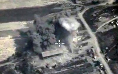 This file photo made from the footage taken from the Russian Defense Ministry official web site on Sunday, Oct. 4, 2015, an aerial view of a bomb explosion in Syria. (Russian Defense Ministry Press Service via AP, File)