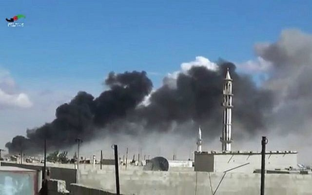 In this image made from video provided by Homs Media Center, smoke rises after Russian airstrikes by military jets in Talbiseh of the Homs province, western Syria, Wednesday, September 30, 2015. (Homs Media Center via AP)