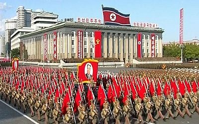 The portrait of late North Korea's founder Kim Il Sung is held aloft during a parade marking the 70th anniversary of the country's ruling party in Pyongyang, October 10, 2015 (KRT via AP Video)