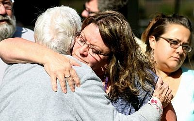 Friends and family are reunited with students at the local fairgrounds after a deadly shooting at Umpqua Community College, in Roseburg, Oregon, Thursday, October 1, 2015. (AP/Ryan Kang)