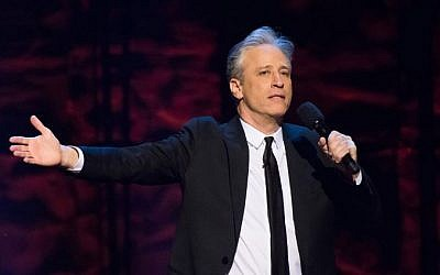 "In this Feb. 28, 2015 file photo, Jon Stewart appears onstage at Comedy Central's ""Night of Too Many Stars: America Comes Together for Autism Programs"" at the Beacon Theatre in New York. (Charles Sykes/Invision/AP, File)"
