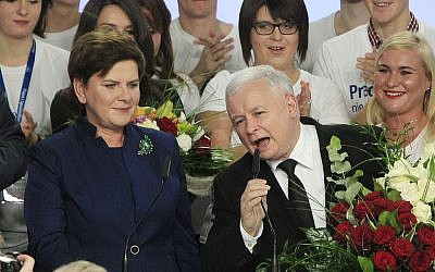 Conservative Law and Justice leader Jaroslaw Kaczynski and Justice candidate for the Prime Minister Beata Szydlo, left, deliver speeches at the party's headquarters in Warsaw, Poland, on Sunday, Oct. 25, 2015. The victory of Kaczynski's Eurosceptic party ends eight years in power of the pro-EU, pro-business Civic Platform which voters accuse of being conformist, detached and focused on power rather than on improving living standards in Poland.(AP Photo/Czarek Sokolowski)